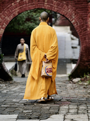 monk-at-the-shaolin-temple-carries-a-burger-king-bag-as-he-walks