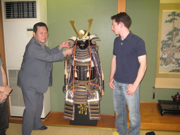 Dr. Miracle examining a set of traditional Japanese armor. Source: The collection of Dr. Jared Miracle.