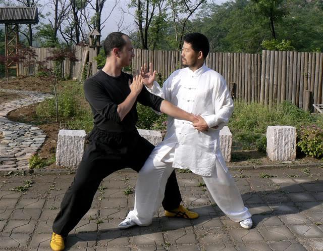 Master Chen Zhonghua and Daniel Mroz playing Tui Shou, Daqingshan, Shandong, China, 2007. Photo by Scot Jorgensen.
