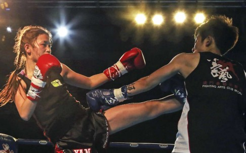Candy Wu fights Macau's Tam Sze Long during the Windy World Muaythai Competition 2014. Source: SCMP