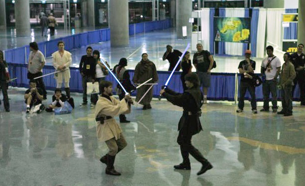 A choreographed reenactment of the final duel in Episode III: Revenge of the Sith. Photo by Jenny Elwick. Source: Wikimedia.
