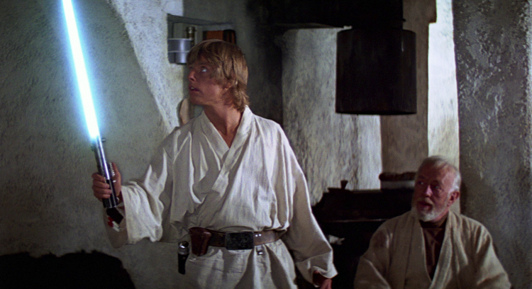 Luke receiving his fathers lightsaber in Episode IV: A New Hope (1977).