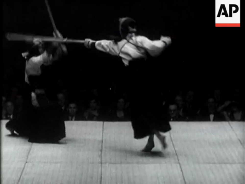 """London Sees the Thrill of Japanese Sports."" A still taken from from a vintage newsreel showing a kendo exhibition match.  1932."