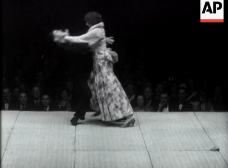 """London Sees Thrills Of Japanese Sport."" A self-defense demonstration by a female martial artist, choreographed to as to be humorous for the audience.  Vintage Newsreel. 1932."
