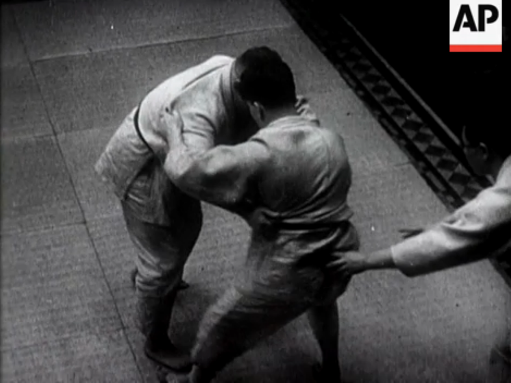 """London Sees Thrill of Japanese Sports."" A Judo match between a British and German competitors.  Taken from a vintage newsreel. 1932."