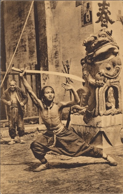"""Well Known Sword Juggler n Shanghai City"" Vintage postcard, 1907-1914.  Source: This particular scan from the digital collection of the NY Public library.  They managed to get a better reproduction that I could."