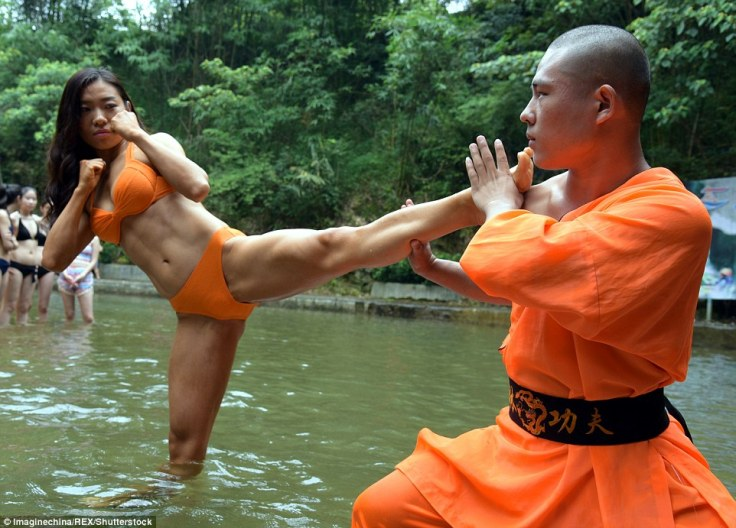 "Swimsuit clad job applicants train with a ""Shaolin Monk"" as part of the application process to be a river rafting guide. Source: http://www.dailymail.co.uk"