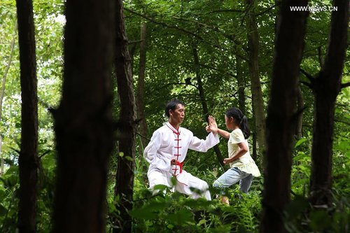 Chinese children learn the martial arts.