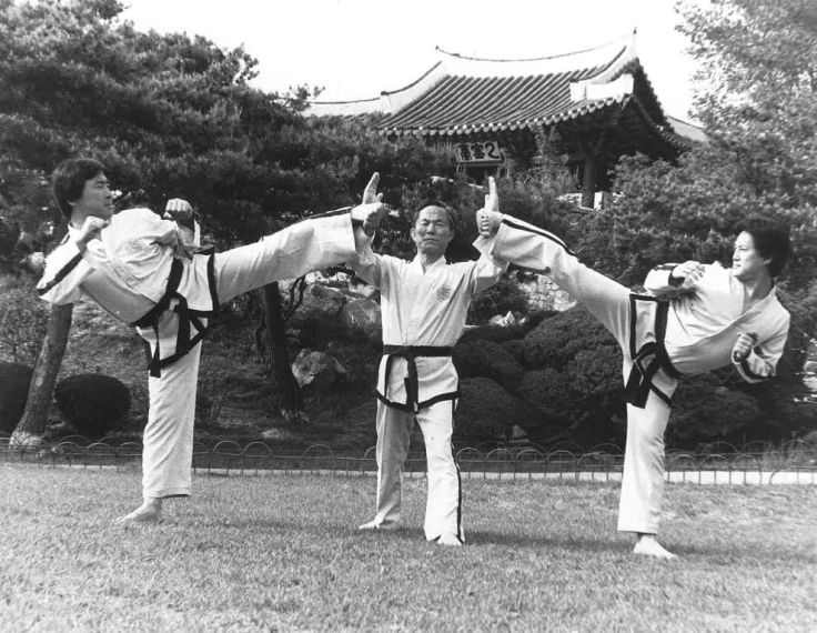 Gen. Choi Hong-Hi, with caption: General Choi blocks kicks from his son Choi Jung-Hwa (on the right) and Park Jung-Taek, my first instructor. PHOTO COURTESY OF GENERAL CHOI.