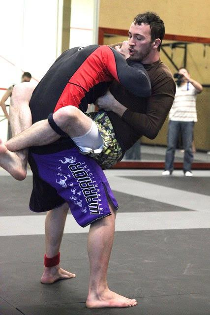 Prof. Kyle Green competing in a grappling tournament.