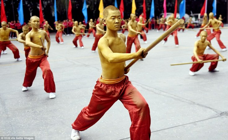 Shaolin's famous bronze men, as reimagined for a public performance.  Source: The Daily Mail.