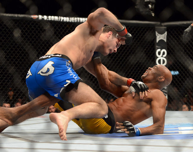 Chris Weidman (red gloves) and Anderson Silva (blue gloves). 2013.