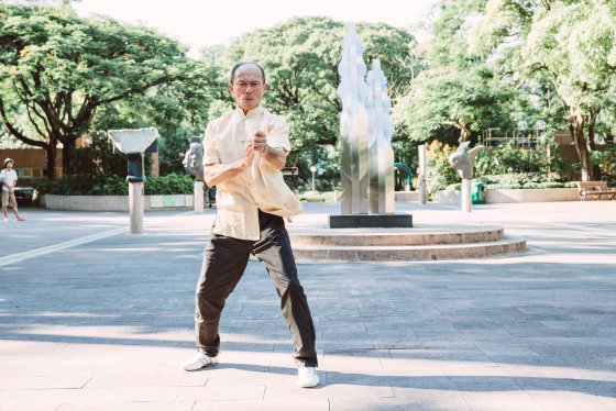 Master Li Tin Loy of the Chow Ka Southern Praying Mantis system in a Hong Kong Part. Source: Time