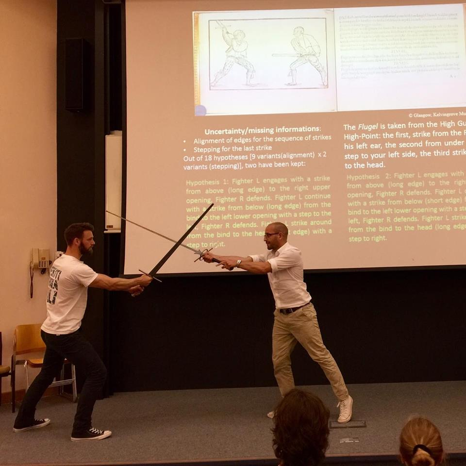 Eric Burkart (left) and Sixt Wetzler engaging in a frank exchange of ideas at the 2016 Martial Arts Studies Conference at the University of Cardiff.