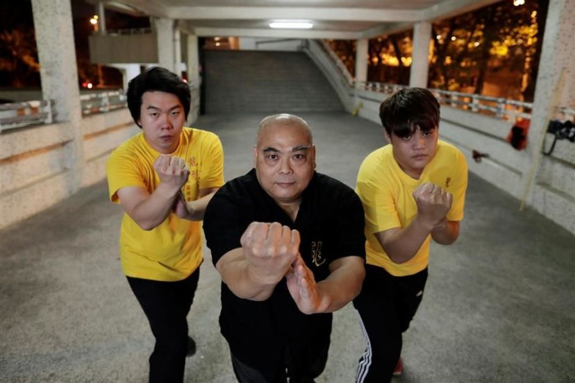 Wong You Kau and students in Hong Kong. Source: Reuters.