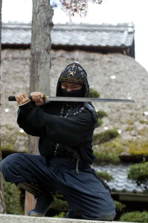 An authentic master of ninjutsu martial art, Kazuki Ukita poses in Ninja costume at the Ninja museum's Ninja residence in the small ancient city of Ueno 08 April 2002. South African national football team selected its base camp in Ueno city, Mie Prefecture for upcoming FIFA 2002 World Cup Korea/Japan. South Africa will play Spain, Slovenia and Paraguay in Group B in the first round of the World Cup. AFP PHOTO / TOSHIFUMI KITAMURA